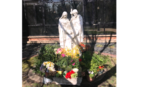 Seen flowers at the Holy Family statue?